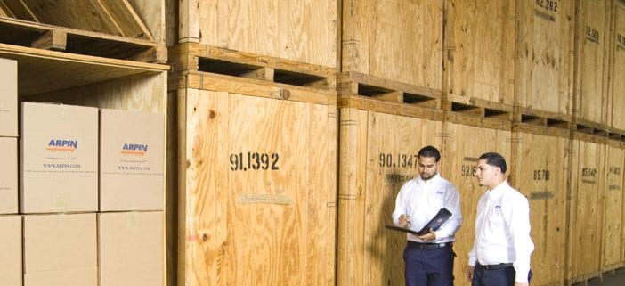 2 men working by storage units