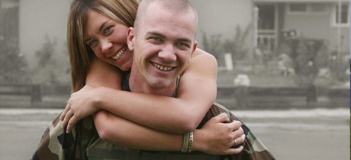 Young military couple hugging and smiling